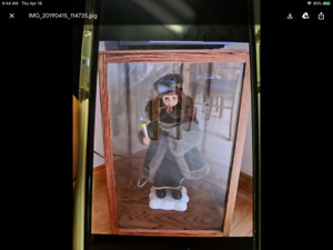 doll with glass cabinet