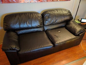 Black leather couch with pull-out bed