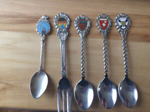 5 Collectable Canadian spoons.