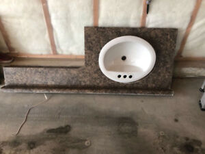 Washrooms Sink with counter top and kitchen counter top