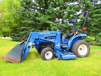 TC18 Yard tractor with front end loader and lawn mower