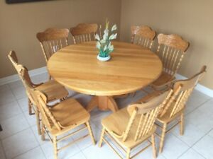 Round wooden dining table with 8 chairs