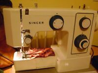 Complete Singer Sewing Machine Model #5124 with accessories.