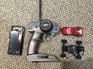 Red LOSI 1/18th RC car + controller