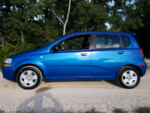 2005 Pontiac Wave 4 door Hatchback with a NEW SAFETY