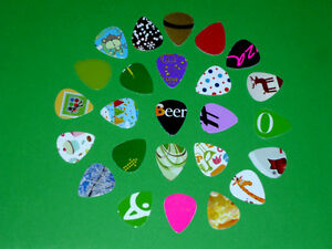 25 Guitar Picks ... Have one of a Kind .. As shown