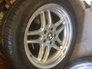 5 BMW tires with chrome rims + tool kit