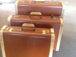 Vintage three piece Dominion trunk set