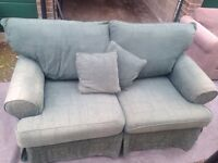 "Green two seater fabric sofa ""free local delivery "" £40"