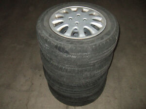 4 TIRES WITH RIMS MUD AND SNOW WITH WHEEL CAPS