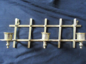 Wall mounted vintage brass candlestick holder
