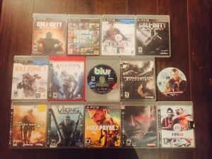 Sony playstation 3 slim - 500gb -15 games - 2 remotes West Island Greater Montréal image 3