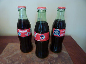 Three different Toronto Maple Leaf Coke Bottles