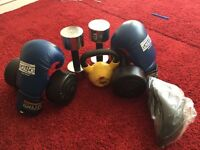 Weights and pro boxing gloves and unused groom guard.
