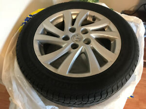 "Mazda 205-55-16"" Alloy Rims with Snowtires"