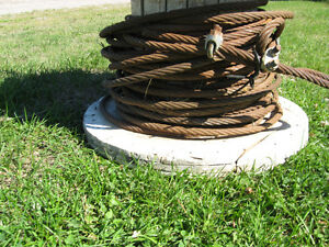 approximately 100' of 1/2 '' tow cable on wooden reel