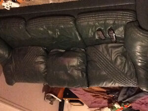 Dark green leather couch and love seat