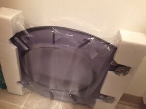 New toilet seat with cover
