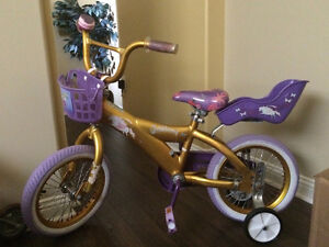 Girls princess bike with doll carrier