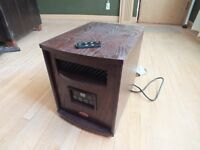 Portable room heater on casters