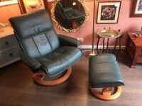 Leather swivel reclining chair & footstool with retro wood feature