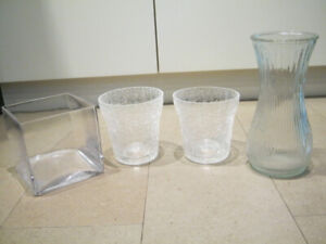 Lot of 4 beautiful simple glass vases -Various sizes. Great deal