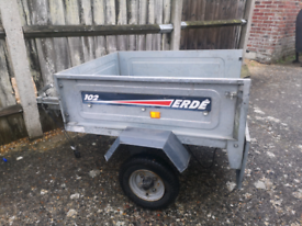 Erde 102 trailer with spare wheels and cover.