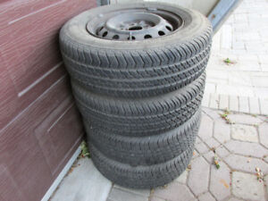 P195/70R14 four tires mounted on 2000 Camry rims.