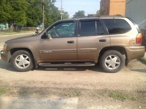 2002 GMC ENVOY SLE sport utility 4 doors 6 cyl, Brown