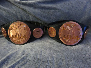 Pair of WWE Tag Team Championship replica belts (Kids size)