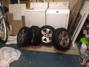Set of 4 summer tires on rims for sale - like new barely used