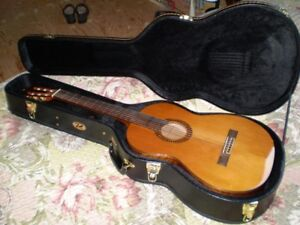 Classical guitar Washburn WC760SW and case--now $490. from $540.