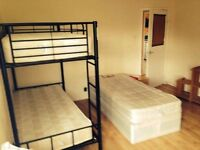 Bed in triple room, central location