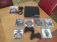 Ps3, 2 controllers and 6 Games.