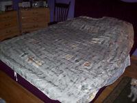 Double bed sized cover for a duvet