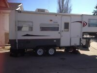 Trade 1997 aero 5th wheel for a side by side