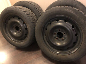 4 mounted used snow tires on black steel rims  205/55 R 16