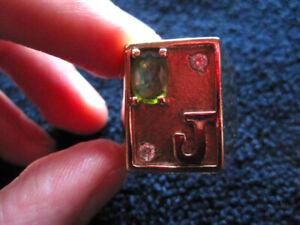 "14k Gold ring, Peridot, 2 diamonds, letter ""J"". Weight 19 grams."