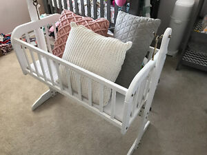 Swinging wooden baby cradle with mattress