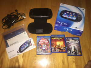 Sony PS Vita with case and 3 games