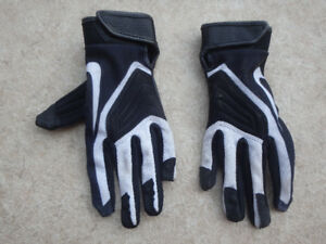 Nike kids small football gloves. Used one season.