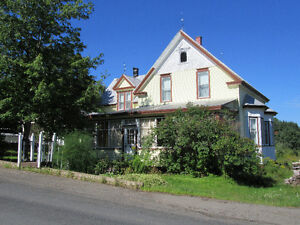 Century Old Home on 100 Acres!