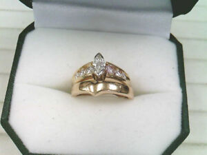 One Lady's 14k Yellow and White Gold, Diamond Ring with one 14k