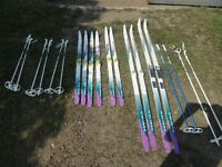 MUTIPLE PAIRS OF CROSS COUNTRY SKIS