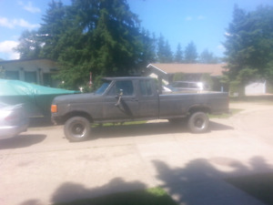 Ford f250 Lariat diesel 4x4 long box with stacks