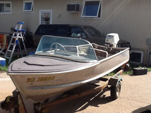 Very cool older 14ft boat with trailer
