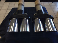Aftermarket universal exhaust tips in new condition. $40,/pair.