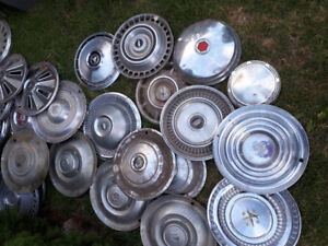 Garage decor Old hub caps  $10 Each  Scripted metal covers