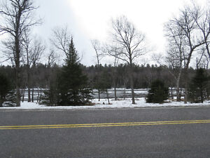 Just minutes from Blind River. Almost 3 acres. Views of River.