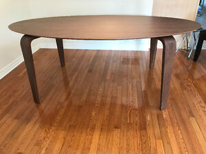 Brand new, never used contempory, splayed leg oval walnut table